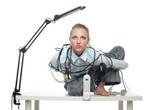 Constrained woman in office royalty free stock photography