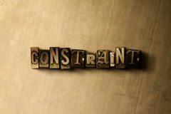 CONSTRAINT - close-up of grungy vintage typeset word on metal backdrop Stock Photography