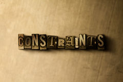 CONSTRAINTS - close-up of grungy vintage typeset word on metal backdrop Royalty Free Stock Images