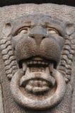 Construção antiga da característica decorativa sob a forma de Lionhead Imagens de Stock