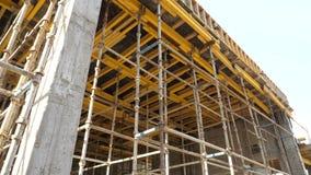 Construção civil das tubulações e do concreto do ferro video estoque