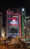 Construção de HSBC e outros arranha-céus em Hong Kong na noite Foto de Stock