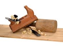 Construção de madeira do ofício do carpinteiro do marceneiro do trabalhador manual do trabalho da ferramenta da plaina imagem de stock royalty free