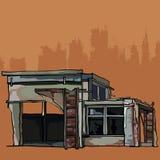 A construção de tijolo dilapidada é uma garagem com anexo Fotos de Stock