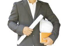 Construção do homem de negócio isolada no fundo branco Com plano do projeto em sua mão Foto de Stock