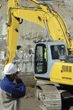 Construção e escavadora Imagem de Stock Royalty Free
