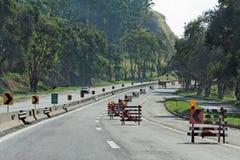 Construção em uma estrada Foto de Stock Royalty Free