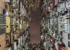 A construção gorda de Yick chamou de outra maneira a selva de Concreto ficada situada em Hong Kong que é um do pagamento humano d Imagens de Stock