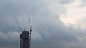 Construção inacabado com o de trás nebuloso maciço Imagens de Stock Royalty Free