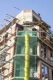 Construção nova com a rampa do andaime e dos restos Imagem de Stock Royalty Free