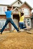 Construção: O par novo salta no excitamento imagens de stock royalty free