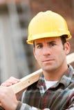 Construção: Trabalhador sério no local home Imagem de Stock Royalty Free