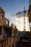 Construções sob a construção e o guindaste Fotos de Stock Royalty Free