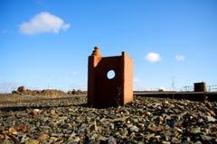 Construcción de carril oxidada extraña con el agujero Imagen de archivo libre de regalías