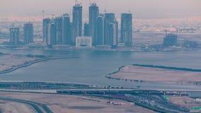 Construcción de nuevos rascacielos en timelapse aéreo del puerto de Dubai Creek Dubai - UAE metrajes