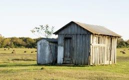 Construcción de viviendas vieja del humo de la granja Imagen de archivo