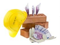 Construcción, financiamiento, sociedades de crédito a la vivienda. Ladrillo imagen de archivo