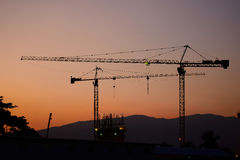 Construcción industrial de las grúas de construcción Imágenes de archivo libres de regalías