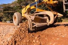 Construcción de carreteras de los terraplénes del graduador Imágenes de archivo libres de regalías