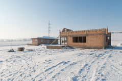 Construcción de las nuevas casas en invierno Foto de archivo libre de regalías
