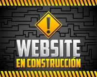 Construccion en вебсайта - вебсайт под испанским языком конструкции отправляет СМС Стоковые Изображения RF