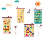 Construcciones de viviendas coloridas con los dibujos Fotografía de archivo libre de regalías