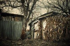 Construcciones quebradas de la aldea Fotografía de archivo