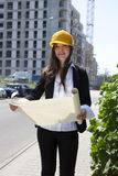 Construcion woman worker with Plans Royalty Free Stock Photos