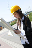 Construcion worker analyzing blueprints Royalty Free Stock Photography
