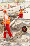 Construcion workers laying brick pavement Royalty Free Stock Image