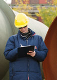 Construciton engineer taking notes Stock Photos