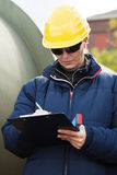 Construciton engineer taking notes Royalty Free Stock Photo
