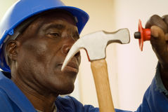 Construciton Worker with Hammer in Motion Royalty Free Stock Images