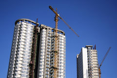 Construct buildings. Two building under construction with blue sky background Royalty Free Stock Photos