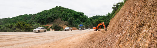 Construct Expand  road. Construct Expand  road in  forest and Mountain Stock Images