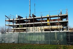 Construct new houses in Italy, construction site, secure tecniques. Construct new secure houses, wood, tools and secure scaffold, construction of buildings in stock images