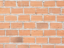 Construct red brick wall. Background Stock Photos