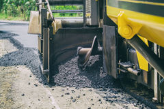 Construct road with asphalt paver machine. Close up construct road with asphalt paver machine Stock Photography