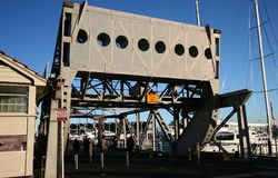 Historic grey Rolling Lift Bridge to Wynyard Quarter at Viaduct Harbor, Auckland, New Zealand. Historical gray draw bridge at harbour with sailboats. Classical stock photography