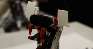 Constructed robot-snake with red teeth.  stock footage