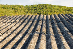 Constructed Roof Material Asbestos. Roof insulation built with asbestos fibrous material prohibited by their carcinogenic effects Stock Photo