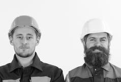 Constructeur, architecte, ingénieur, travailleur avec le visage gai, fin, l'espace de copie Amis au concept de travail Hommes dan Photo libre de droits