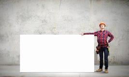 Constructeur avec la bannière Images stock