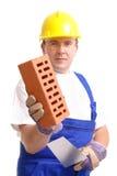 Constructeur avec la brique et la truelle Images libres de droits