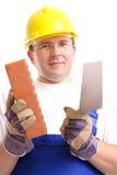 Constructeur avec la brique et la truelle Photographie stock libre de droits