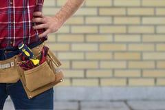 Constructeur avec la ceinture des outils photos libres de droits