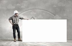 Constructeur avec le panneau d'affichage Images stock