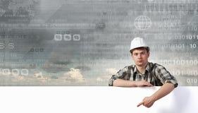 Constructeur avec le panneau d'affichage Photos stock