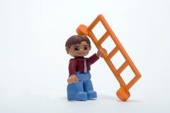 Constructeur avec une échelle photo libre de droits