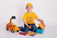 Constructeur, bébé de constructeur, constructeur de profession, travailleur de profession, travailleur, constructeur d'enfant Photos libres de droits